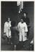 [Untitled, Four women standing by a city street and parking sign].; Heron, Reginald; 1963; 1971:0531:9999