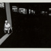 [Man seated beneath a bridge]; Uzzle, Burk; 1979:0044:0001