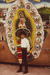 Young Pilgrim In Front of Backdrop By the Late Jacinto Rojas, Shrine of Guadalupe; Oettinger, Marion; 1989; 2009:0058:0007