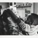 [Untitled, Nursery worker holding a little boy]. ; Heron, Reginald; 1966 ; 1972:0155:9999