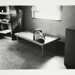[Untitled, little boy sleeping on cot in a nursery]. ; Heron, Reginald; 1966; 1972:0162:9999