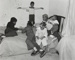 [Children on a Bed with a Puzzle]; Crescenzi, Christine; 2000:0098:0001