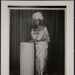 Untitled [Portrait of woman standing next to a pillar]; Daramola Photography Studio; ca. 1960s; 2009:0047:0001