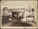 Untitled, (Room with fireplace mantle, paintings and other decorations displayed on wall). ; Moulton-Erickson Photo Co.; c.a. 1890; 1977:0074:0010