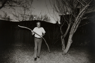 Untitled [Man with branch]; Hume, Sandy; 1976; 1977:0099:0001