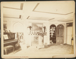 Untitled, (Room with wood burning stove, piano and paintings displayed).; Moulton-Erickson Photo Co.; c.a. 1890; 1977:0074:0007