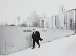 New York Is, [Man walking alongside wall, cityscape in background]. ; Ogawa, Takayuki; c. a. 1970; 1971:0285:9999