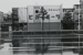 Untitled [Storefronts and wet road]; Dane, Bill; ca. 1974; 2011:0014:0047