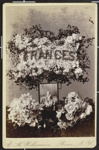 [Shrine with the name frances written in flowers and picture of young child]; E. H. Williamson; 1974:0040:0029