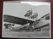 Twin engined flying boat sitting outside Holymans Airways Hangar; TAM2012.1417