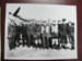 Pilots and others standing in front of a Supermarine Spitfire; TAM2012.1423