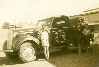 Four children standing in front of ute, Hughenden 1947; Unidentified; 2013-45