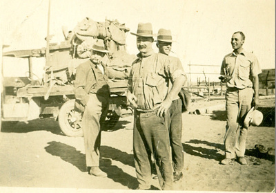 Group of men standing in front of loaded truck, Tiverton Station, Queensland, 1940s; Unidentified; 1940s; 2013-138