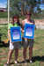Australia Day Young Citizen Award winners Alisa Paine and Kirby Edwards, standing in Robert Gray Park, Hughenden, 2004; Flinders Shire Council; 26 January 2004; 2012-315