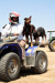 Jane McNamara on quad bike with Australian Kelpies on the back at Abbotsford Station, 2011; Melissa Driscoll; 14 September 2011; 2012-343