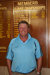 Chad Driscoll standing in front of the Hughenden Golf Club Honour Board, 2010; Melissa Driscoll; 30 October 2010; 2012-355