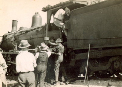 Group of men rescuing train driver after crash, Moselle, Queensland 1938; Unidentified; 2013; 2013-98