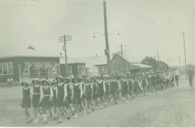 School children marching on Gray Street, Hughenden, 1940s; Unidentified; 1940s; 2012-9