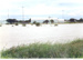 Station Creek in flood, Hughenden, 2002; Unidentified; 2002; 2012-42