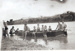 Group of people with boat in Flinders River, Hughenden, 1930s?; Unidentified; 2011-313