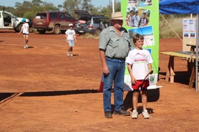 Mt Walker Fun Run Under 12 Boys winner Will Angus with Councillor Sean O'Neill, Hughenden 2012; Flinders Shire Council; 17 June 2012; 2012-257
