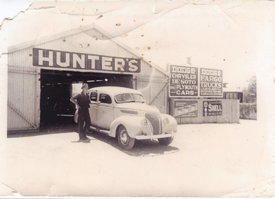 Hector Hunter outside Hunter's Garage, Hughenden, 1940s; Unidentified; 2011-62