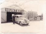 Hector Hunter outside Hunter's Garage, Hughenden, 1940s; Unidentified; 2011-62