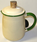 Electric enamel jug. Off white with green edging and handle. Cork top. Minor rust around inside and lid. Slight discolouration from use on inside.; 1860-1900; HOU1/8