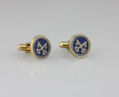 Cuff links, gold tone and enamel cufflinks bearing...