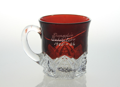 Mug; commemorative glass mug from the Dunedin Exhi...