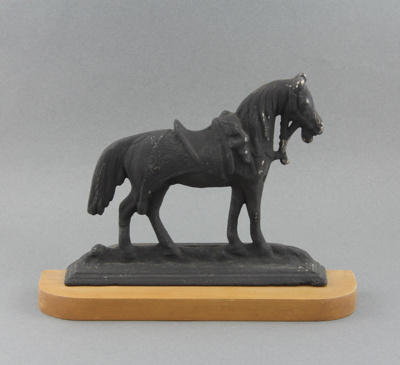 Model; a hollow-backed cast iron model of a horse,...