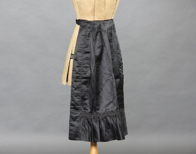 Apron, dress; a black dress apron with a v shaped ...