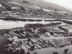Photograph [1978 Flood, aerial view north end of Main and Kana Streets, Mataura]; Henderson, Keith Raymond; 1973; MT2017.18.15