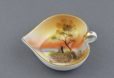 A small heart-shaped dish, with loop handle which ...