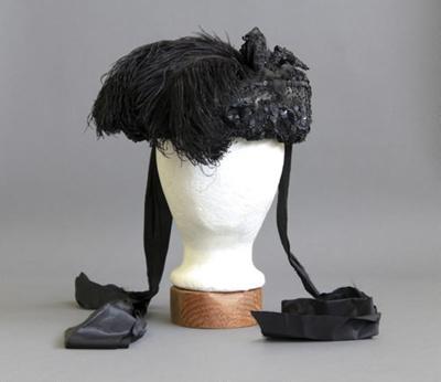 Bonnet; a women's black bonnet decorated with glas...