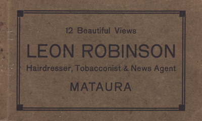 A postcard album which originally contained 12 bla...