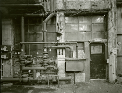 Black and white photograph of pipes at the decommi...