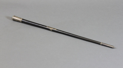 Conductor's Baton; tapered black wooden baton with...