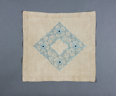 Cushion cover; ecru coloured cover with blue diamo...