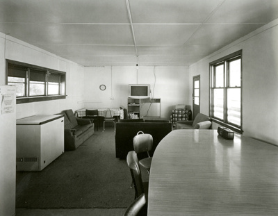 Black and white photograph of the dining room in t...