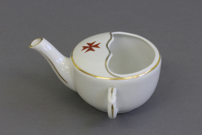 Pap boat; a white pottery pap boat with gold trim ...