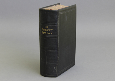 Hymnal; It is bound in leather with gold leaf on t...