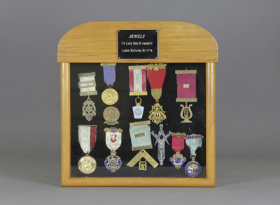 Medals, 12 mason's jewels (medals) in a glazed pre...