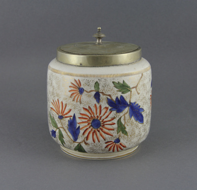 Biscuit barrel; a floral patterned china barrel wi...