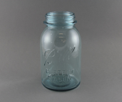 A blue-tinted glass jar, used for bottling preserv...