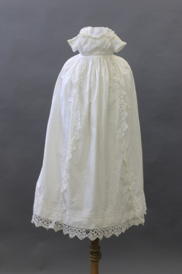 A baby's white christening gown with separate pett...