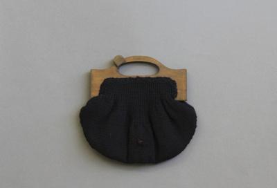 Handbag; a handmade black knitted woollen handbag ...