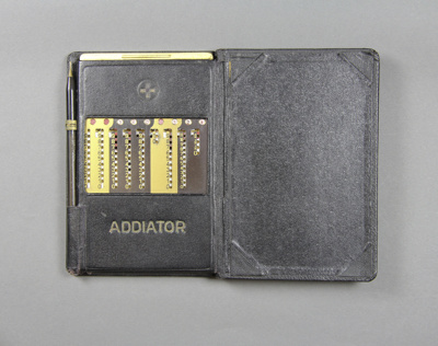 Addiator, Calculating Machine in a leather walllet...