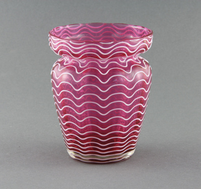 Vase; a rose-red coloured glass vase with a patter...