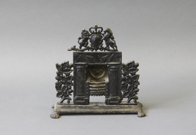 Model; a cast iron model of an open fireplace with...